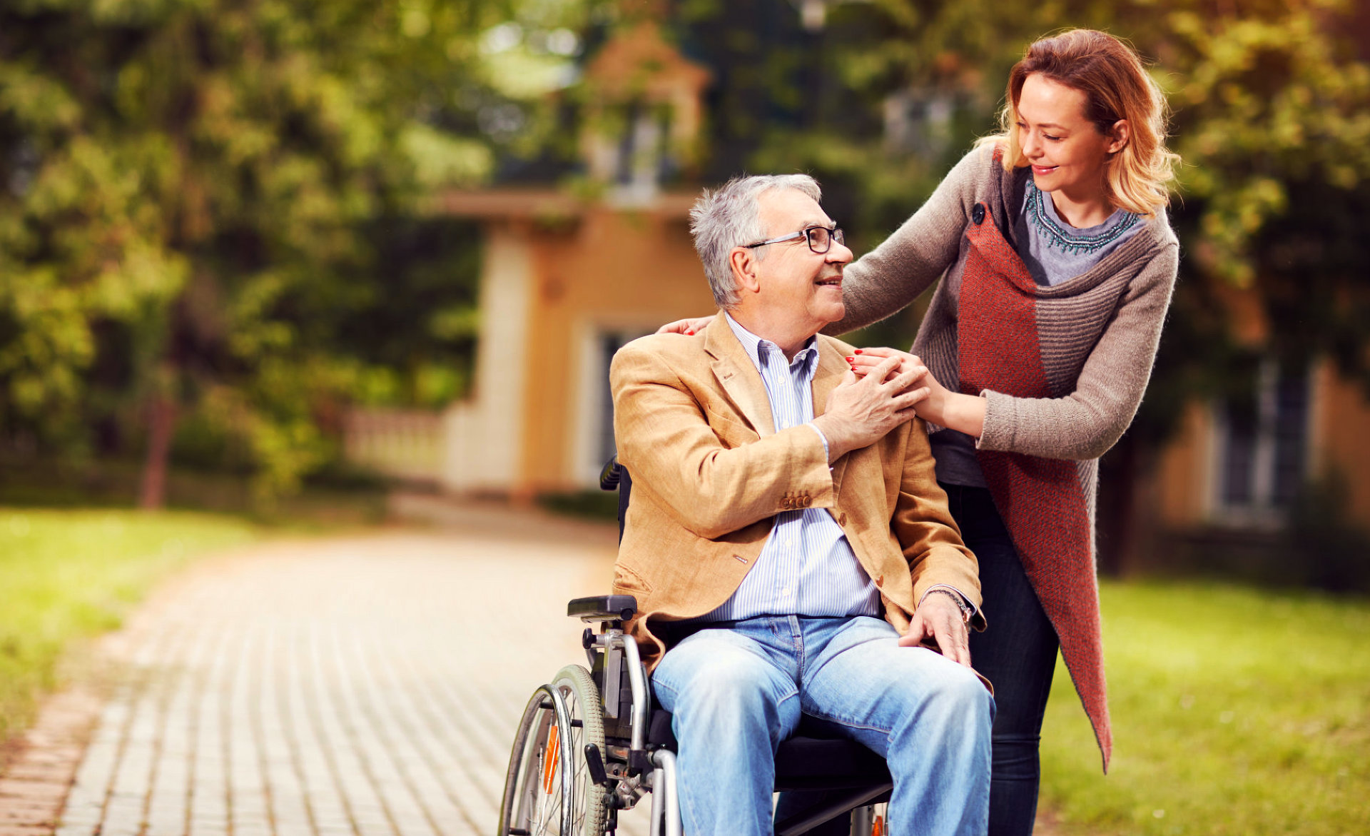 portrait of caregiver and senior woman smiling each other