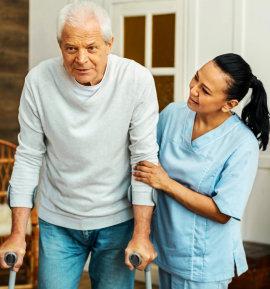 caregiver helping the senior man