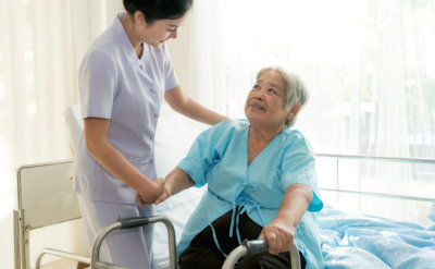 portrait of nurse and senior woman looking at each other