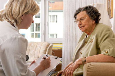 portrait of senior woman being interviewed by a counselor