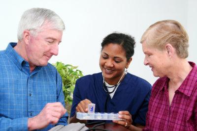 nurse suggesting to senior man on what medicine to take