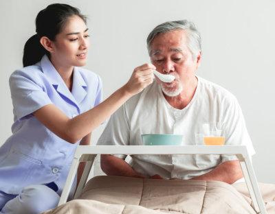 nurse caring senior woman